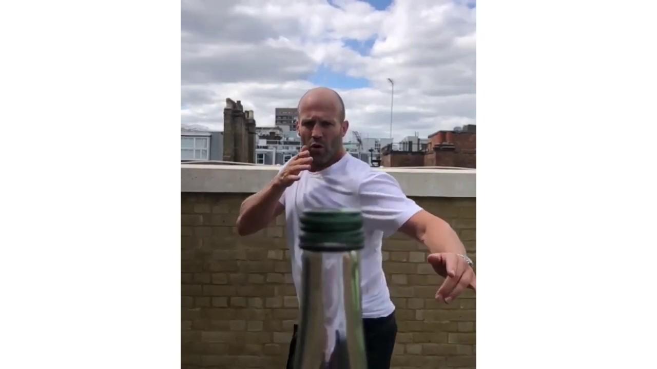 Jason Statham removes a bottle cap