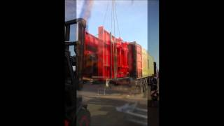 Loading MAC Bale Trailer into a large container carrier