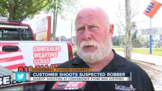 Armed robbery suspect shot by customer