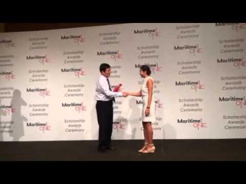 Alissa Ong receiving her scholarship