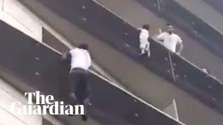 Paris hero climbs four-storey building to rescue dangling child