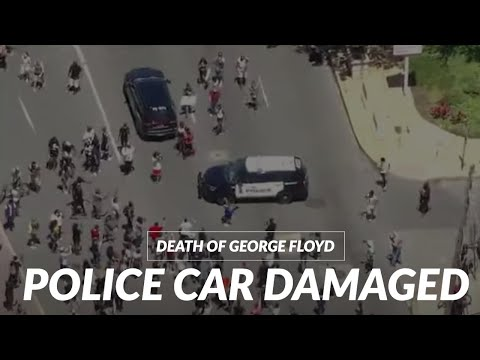 George Floyd protesters smash windows of a police SUV in Wilmington, Delaware