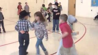 2nd graders square dance to