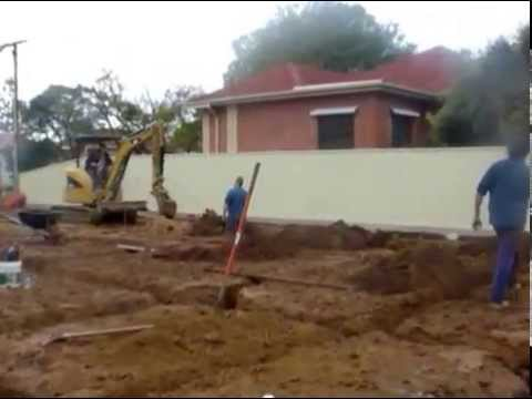 Digging the trenches footings for a house slab for Digging foundation for house