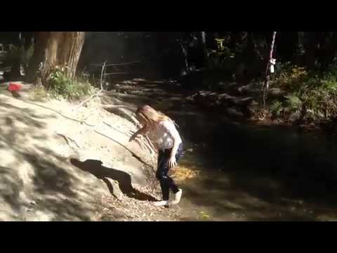 Woman falls off rope swing into creek while fully clothed