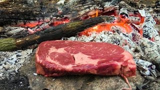 Cooking Meat Survival Style on a Rock