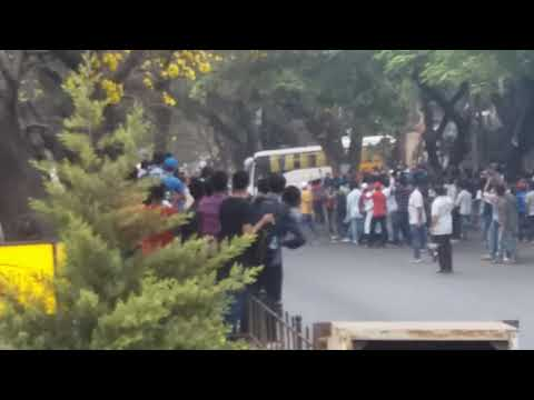 Indian cricket team bus coming out of Chinnaswamy Stadium