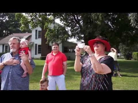 Military sons surprise parents by coming home and marching in hometown 4th of July parade