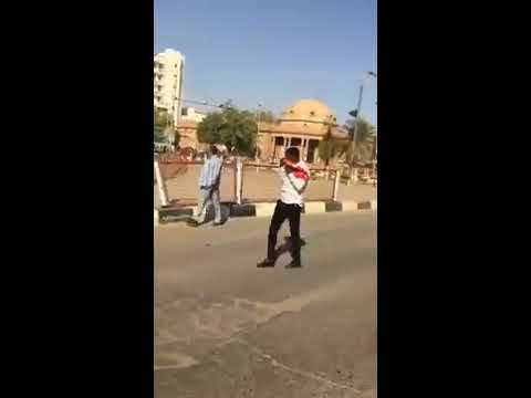 Sudanese Security forces firing their automatic guns toward civilian protesters