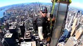It's This Man's Job to Dangle From Skyscrapers