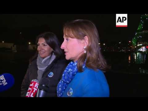 Eiffel Tower lit up for start of climate pact