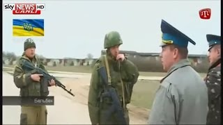 Russian troops fire shots over the heads of Ukrainian air force personnel in Belbek Crimea