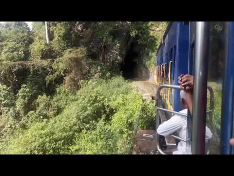 Nilgiri Mountain Railway ooty..Toy Train crossing Tunnel