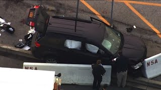Shots fired outside NSA when SUV slams into security barrier
