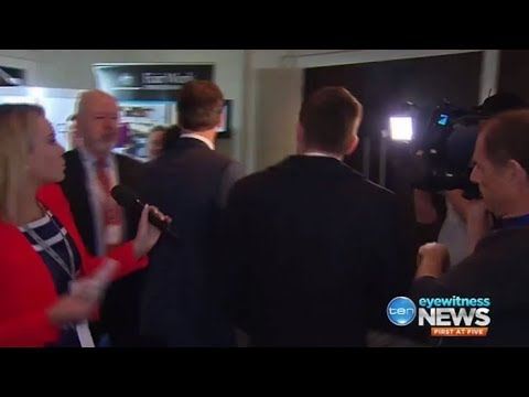 Angus Taylor hides from the media for 30 mins before escaping through a rear door
