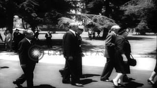Joe DiMaggio and others at the funeral of Hollywood star Marilyn Monroe in Los An...HD Stock Footage
