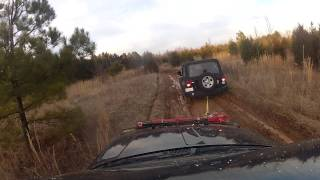 jeep grand cherokee wj mudding and pulling out a jeep wrangler