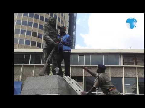 Man chains himself on Dedan Kimathi statue