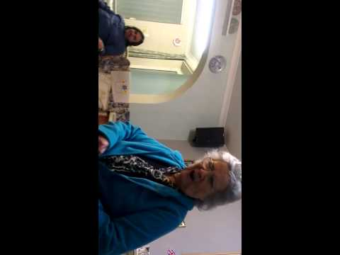 Dad opening his Christmas ties. Mum not happy!