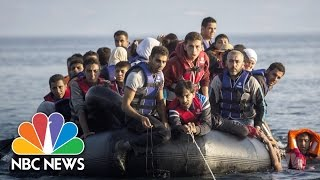 Syrian Refugees Come Ashore In Greece As Beachgoers Watch   Short Take   NBC News