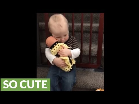 Toddler prepares to become big brother by caring for doll