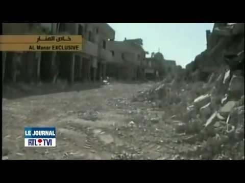 Syrie - Des terroristes belges aident à égorger un civil syrien chiite.