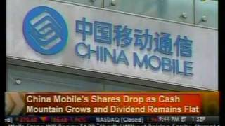 China Mobile's Shares Drop - Bloomberg