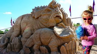 kids and Giant Sand Sculptures. Sand Sculptures exposition in Jelgava