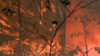 California wildfires claim first victim