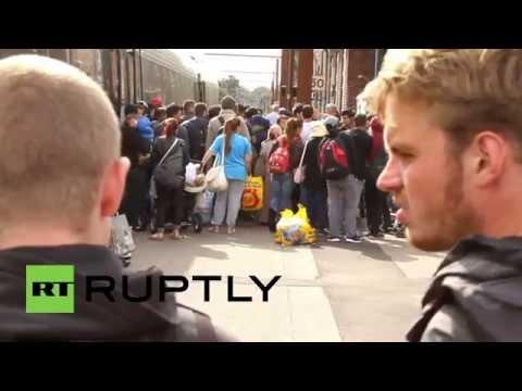 Denmark: Stranded refugees board trains to Copenhagen
