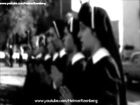 November 25, 1963 - Roman Catholic nuns kneel and pray in Dealey Plaza,  Dallas, Texas