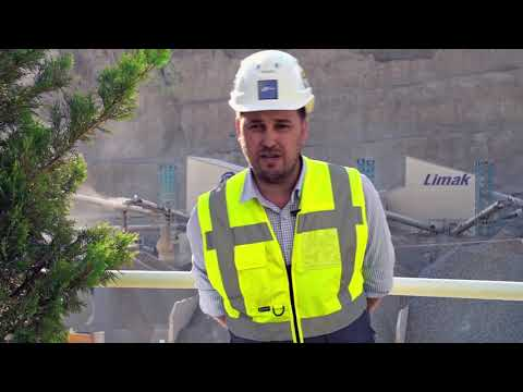 Liebherr - tower cranes build the third largest double arch dam in the world