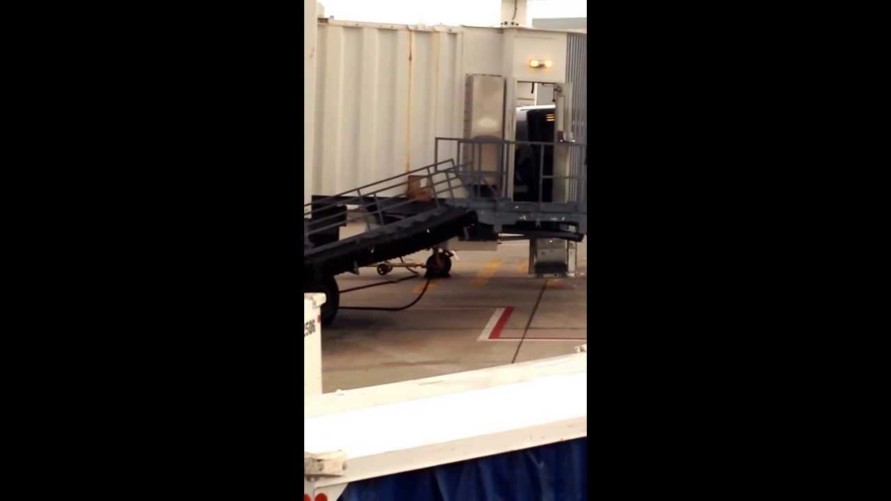 united airlines jetway worker throwing gate checked baggage