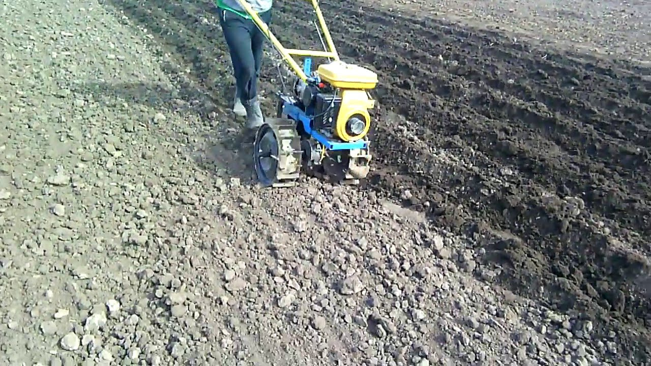 Homemade walk behind tractor  Plowing