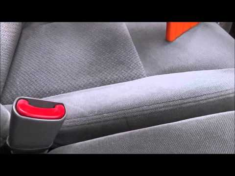 Removing stains on automotive upholstery.