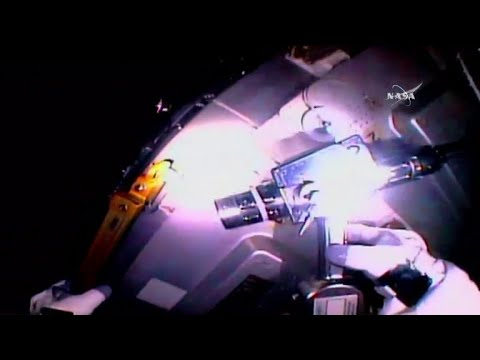 Astronauts make space station repairs in lengthy spacewalk