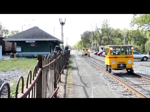 Track cars passing the Rochester & Genesee Valley Railroad Museum