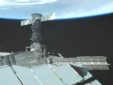 ISS camera captures Earth below the Russian service  module Zvezda and the Soyuz spacecraft