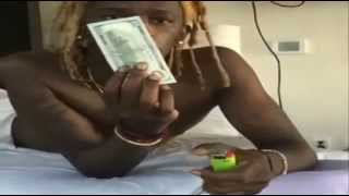 Young Thug Burns $100 Bill To Light Up Blunt And Show How Rich He Is.