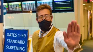 airport worker goes insane about cameraman filming checkpoint (EPIC FAIL)