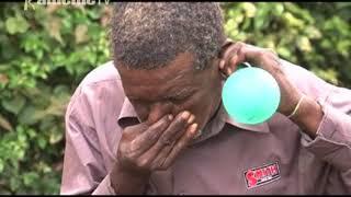 Muthuri umwe kuuma Banana, Kiambu kuhuhira balloon na gutu