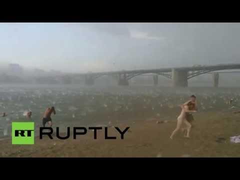 Hail Fire? Golf ball sized frozen rain pelts Siberian beachgoers