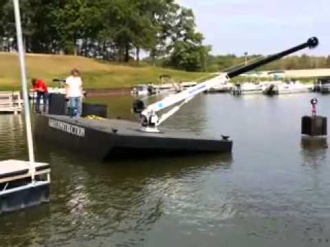 12x30x3 crane barge with 5000 lbs auto crane and 90 hp Mercury.