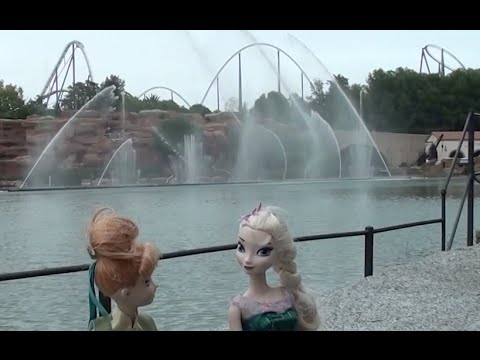 Anna and Elsa dolls go to a theme park, enjoy the amusement rides & try a real roller coaster