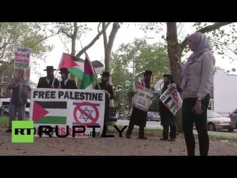 "USA: Muhammed Allan's family lead march on anniversary of ""Gaza Massacre"""
