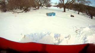 Timberjack skidder plowing snow