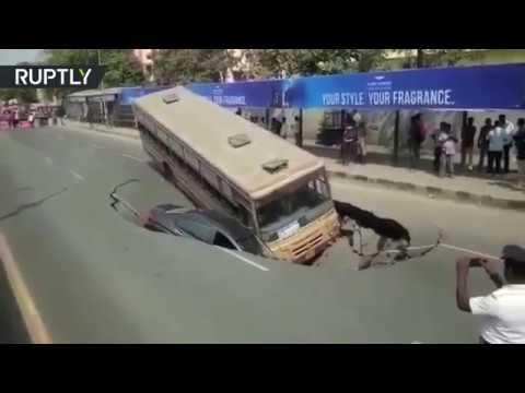 Large sinkhole swallows bus & car in Indian Chennai