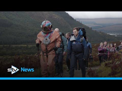 Fundraiser Climbing Ben Nevis In Deep-sea Diving Suit