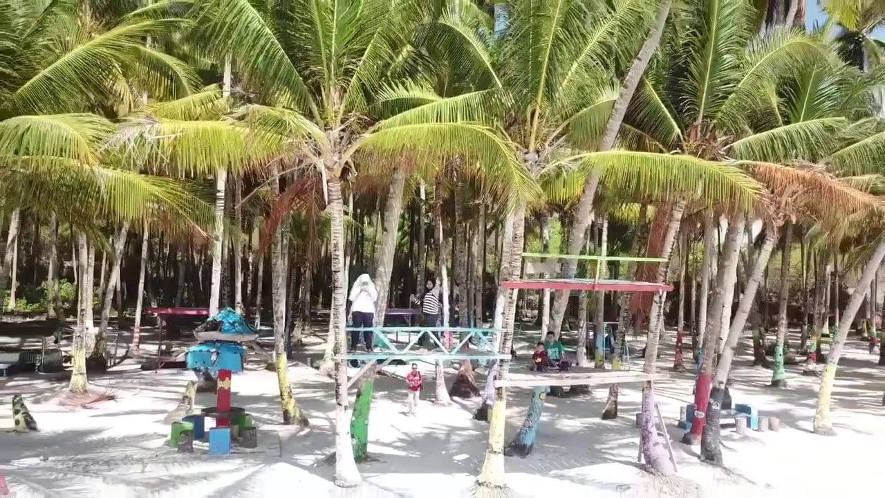 Sekilas menikmati wisata Di Pantai Membuku, Ereke, Buton Utara ...