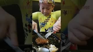 Eating steak wearing swimming suit